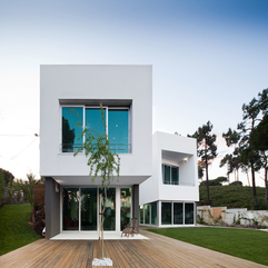 Architecture Teerace Twin Block House Design With White Exterior - Karbonix