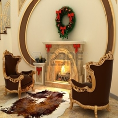 Armchairs By Fireplace With Christmas Tree Decorations In - Karbonix