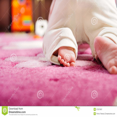 Baby Crawling On Pink Carpet Royalty Free Stock Photography - Karbonix