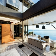 Black Cushions Luxurious Lounge Space Overlooking Sea View White Sfa - Karbonix