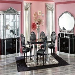 Cute Pink Dining Room Design With Ellipse Black Table On The Black - Karbonix