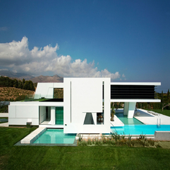 Exterior Impressive Modern Homes With White Unique Shape Wall And - Karbonix
