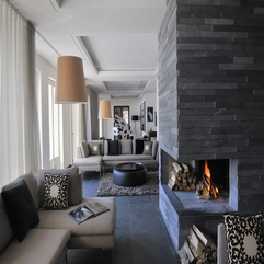 Front Of Grey Sofa White Space Stone Fireplace - Karbonix