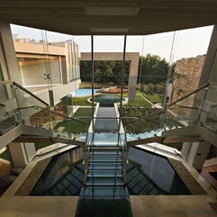 Glazed Space With Pond Under It Viewed From Upstairs Steel Stairs - Karbonix