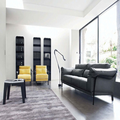Living room interior with modern dark sofa designs lovely for Interior design living room description
