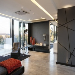 Open Fireplace Placed Between Black Orange Ornament Silver Sculpture In Modern Style - Karbonix