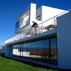 Residence Completed With White Fences For Balcony In Modern Style - Karbonix
