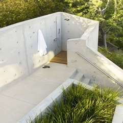 Shower Area With Wooden Floor Upper Level White Stairs - Karbonix