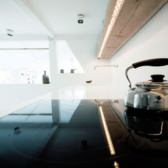 Stove With Glossy Silver Kettle On It Modern Black - Karbonix