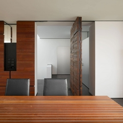 Wooden Door With White Wall View Open Spinning - Karbonix
